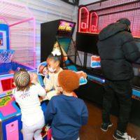 J McAllister Events Guests playing Mini Basketball Skeeball and NBA Hoops Arcade Games